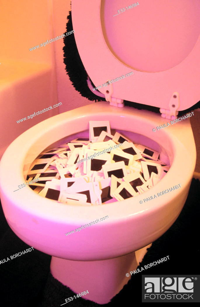 Stock Photo: 35mm slides tossed in the toilet.