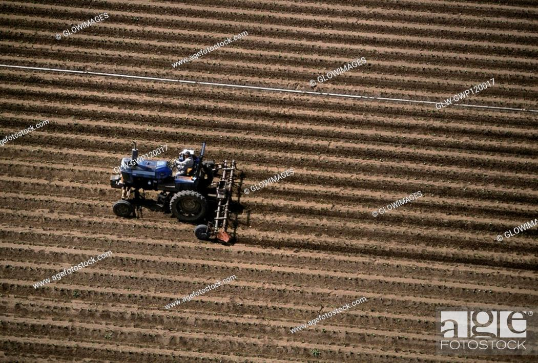 Stock Photo: Aerial, plowing farm field.