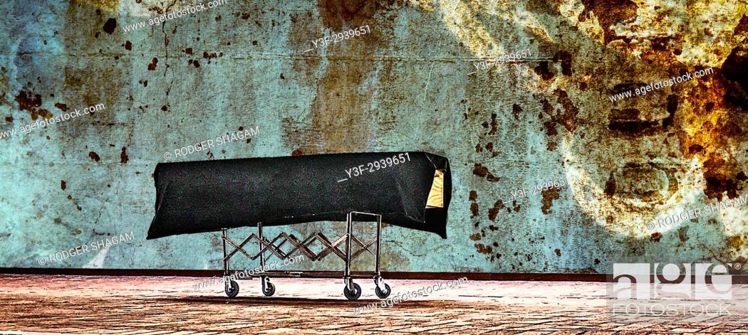 Stock Photo: Coffin on a trolley. Waiting to go . . .