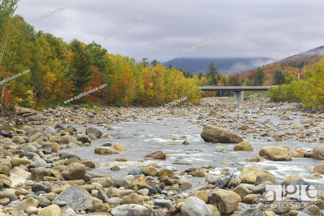Stock Photo: Autumn foliage along the East Branch of the Pemigewasset River, just below the Loon Mtn. Bridge, in Lincoln, New Hampshire on a cloudy autumn day.
