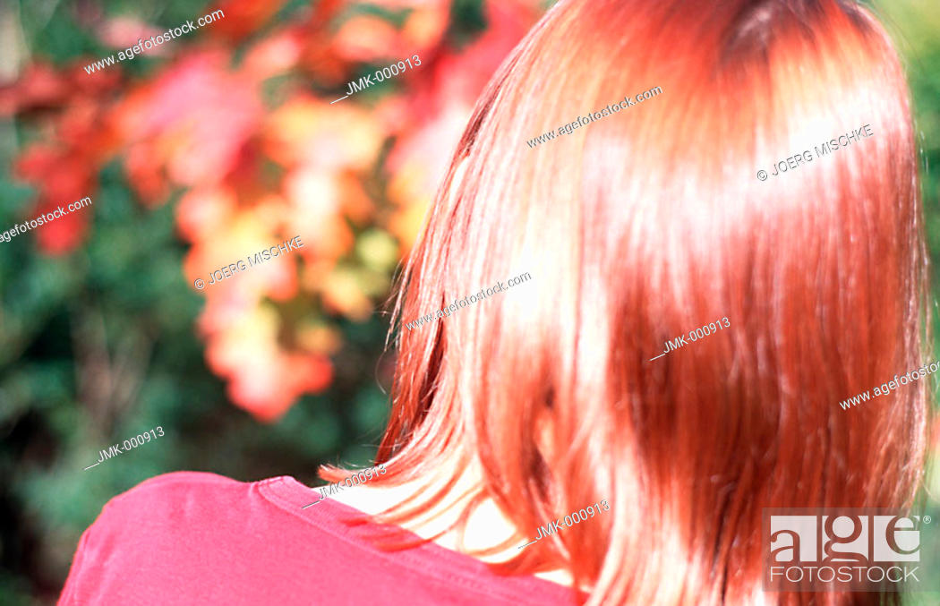 Stock Photo: Back of a little girl in the garden.