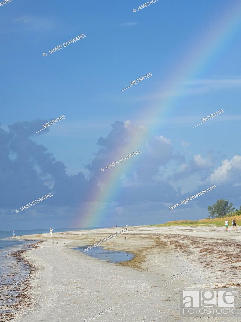 Stock Photo: Rainbow over Sanibel Island Lighthouse Beach Park on the Gulf of Mexico on Sanibel Island Florida.