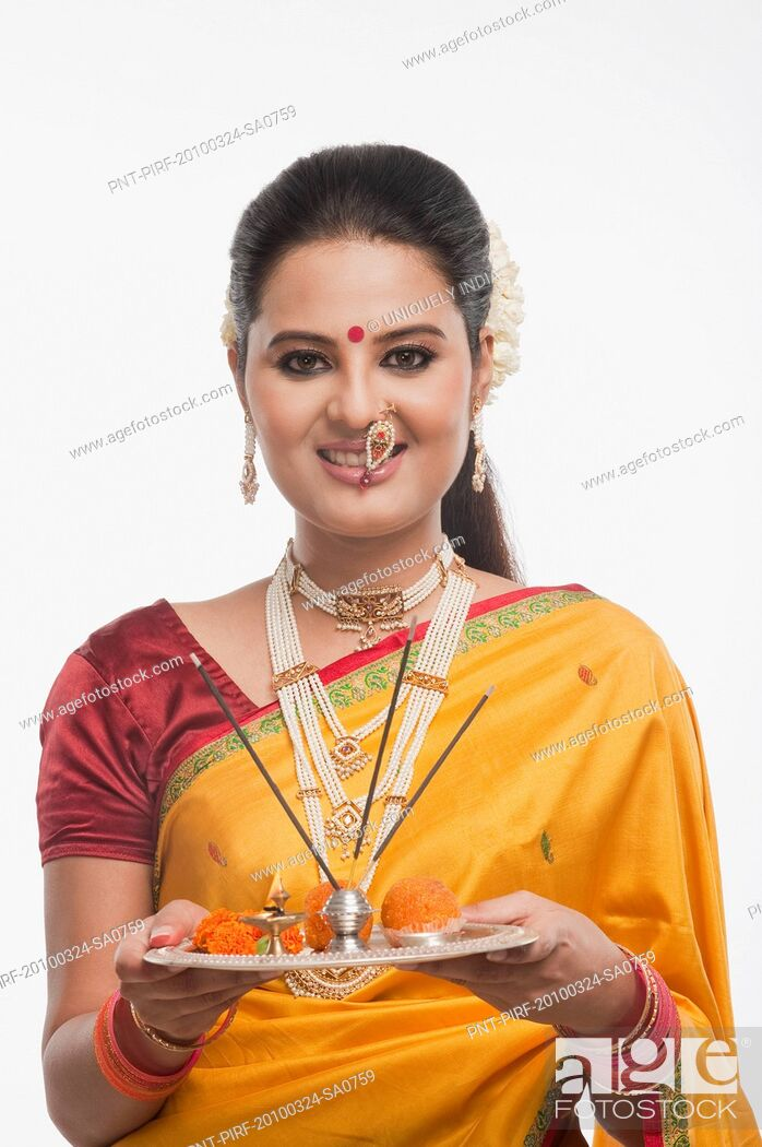 Stock Photo: Portrait of a woman holding a plate of religious offerings on Gudi Padwa festival.