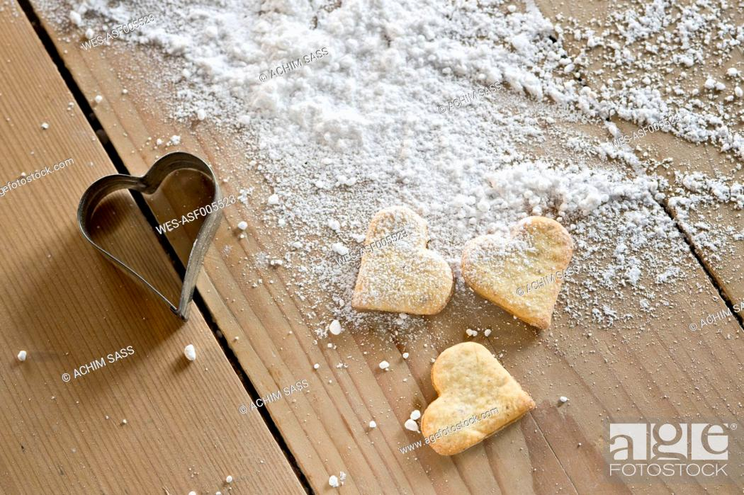 Stock Photo: Heart-shaped shortbreads, icing sugar and cookie cutter.