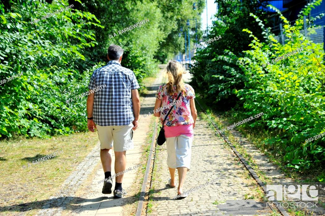 Stock Photo: Couple on an old railway path, Stockholm, Sweden.