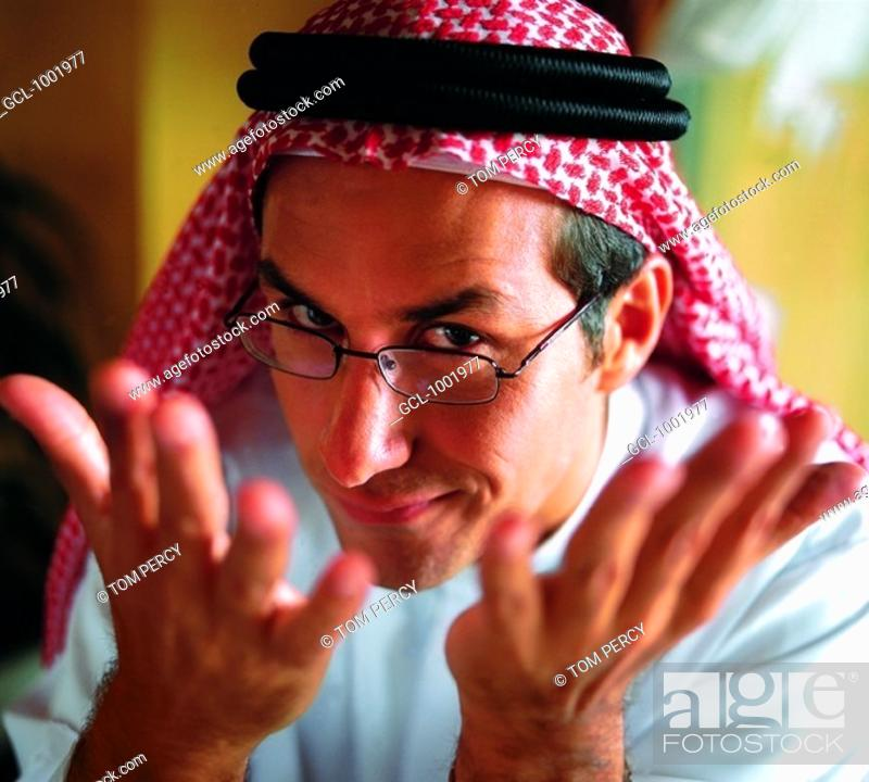 Stock Photo: Arab man gesturing and looking over his glasses.