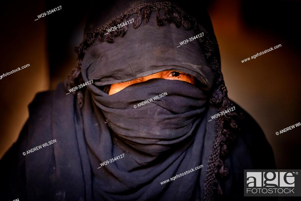 Stock Photo: A woman of Arab descent photographed in a remote village in Southern Morocco, North Africa.