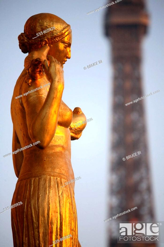 Stock Photo: Closed up view of a gilded bronze statues on the central square of the Palais de Chailot with Eiffel Tower in background, Paris. France.