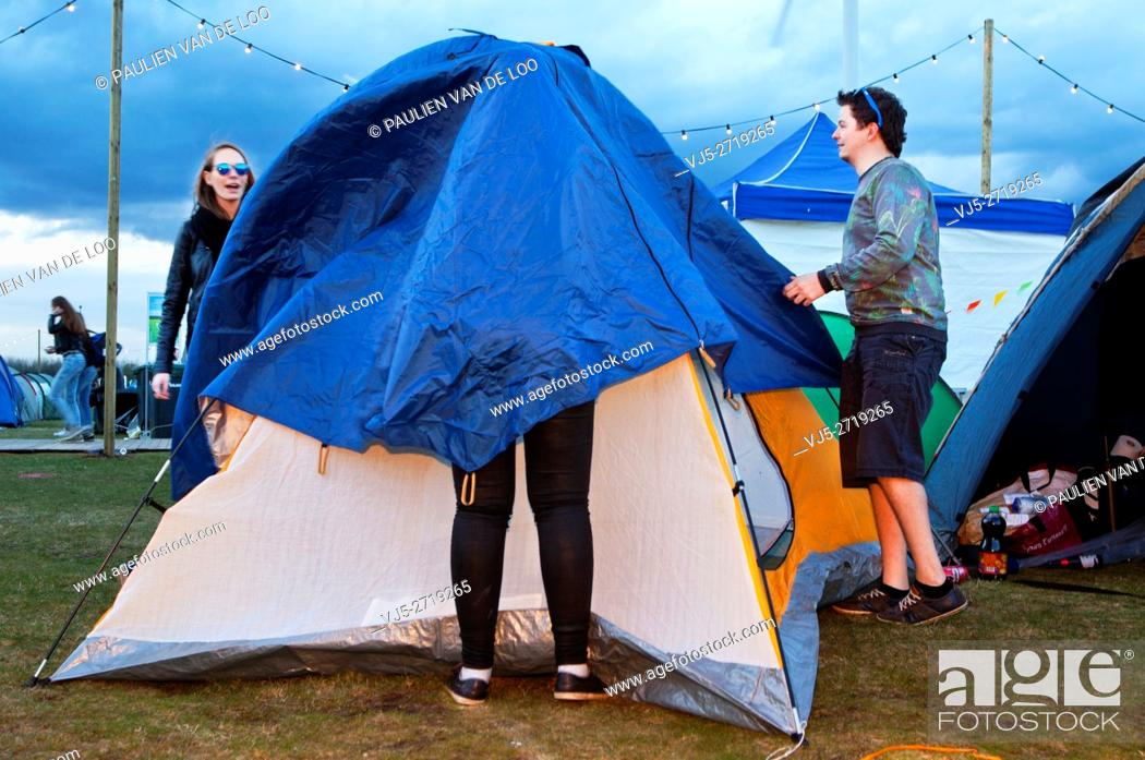 Stock Photo: Lommel, Belgium, girls and boys planning the night and pitching their tent, place to sleep.