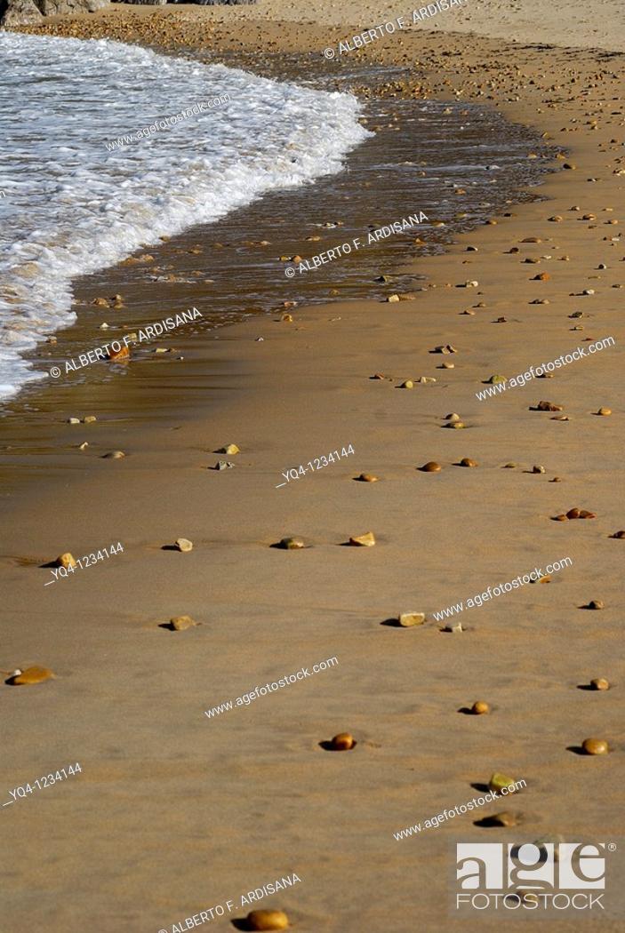 Stock Photo: stones carried by the tide Cuevas del Mar beach Llanes, Asturias.