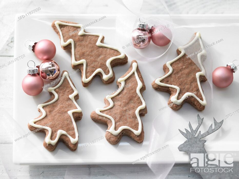 Stock Photo: Chocolate Christmas tree biscuits.