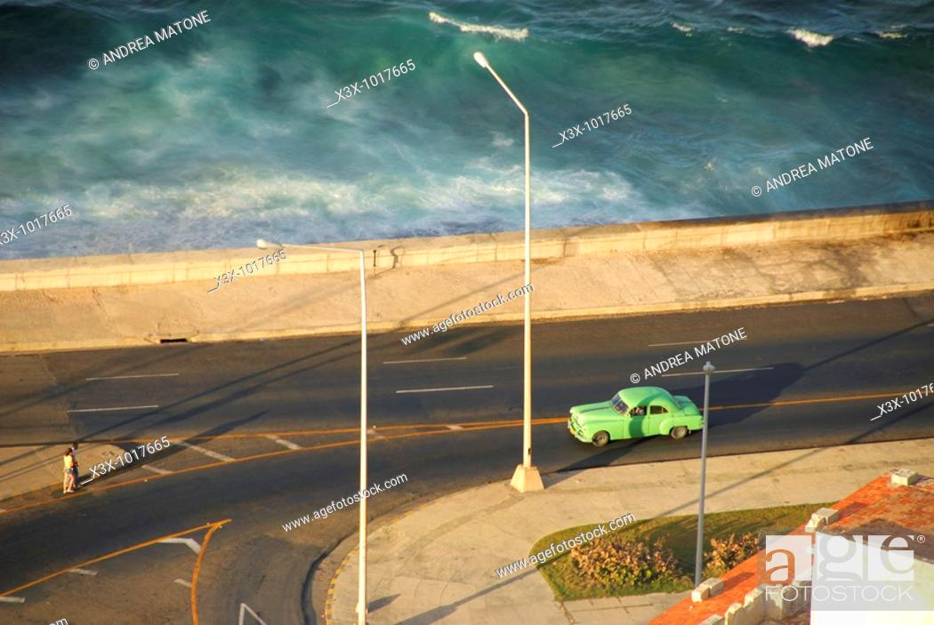 Stock Photo: Aerial view of a green car in the El Malecon Havana skyline Cuba.