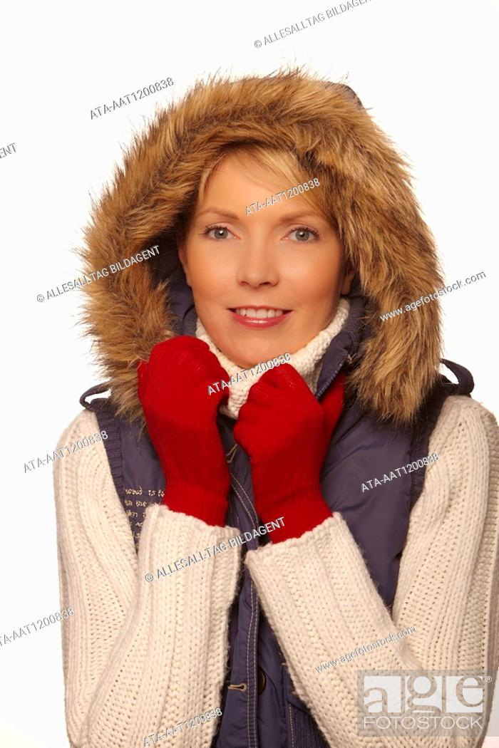 Stock Photo: Portrait of a freezing woman with red gloves.