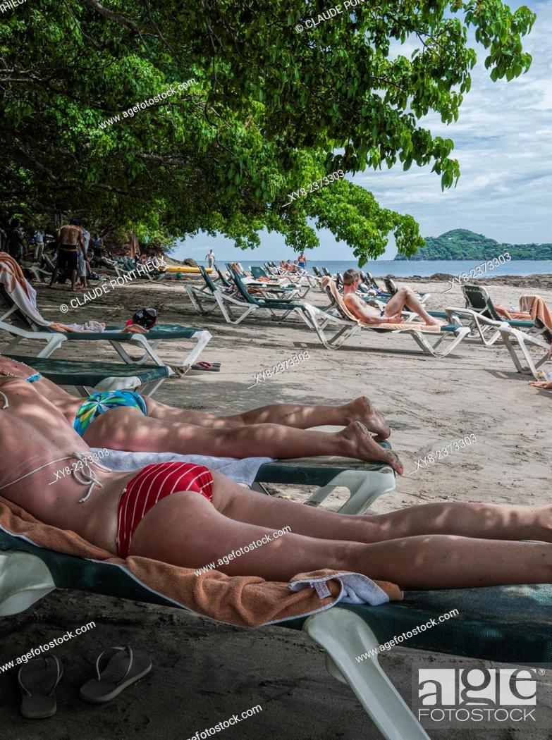 Stock Photo: Vacationists relaxing at Occidental Grand Papagayo Resort beach,Guanacaste, Costa-Rica.