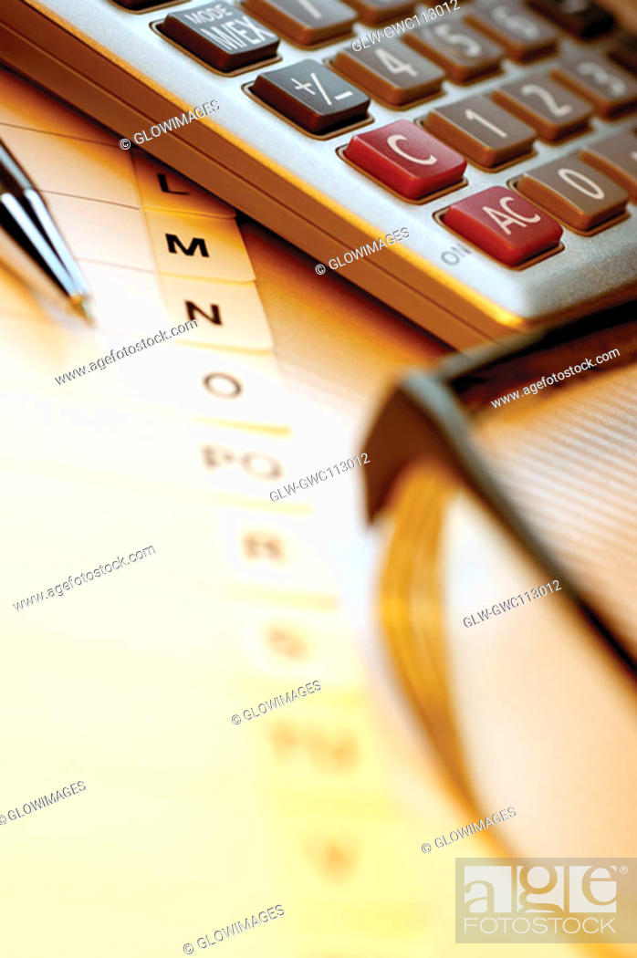 Stock Photo: Close-up of a calculator with a pen and a personal organizer.