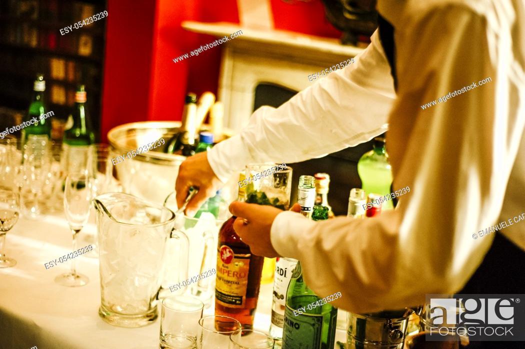 Stock Photo: Barman prepares cocktails.