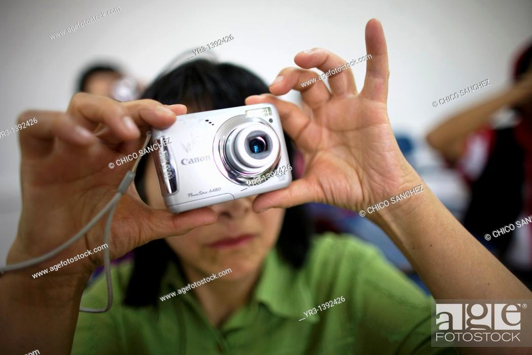Stock Photo: Blind and visually impaired students take a picture.