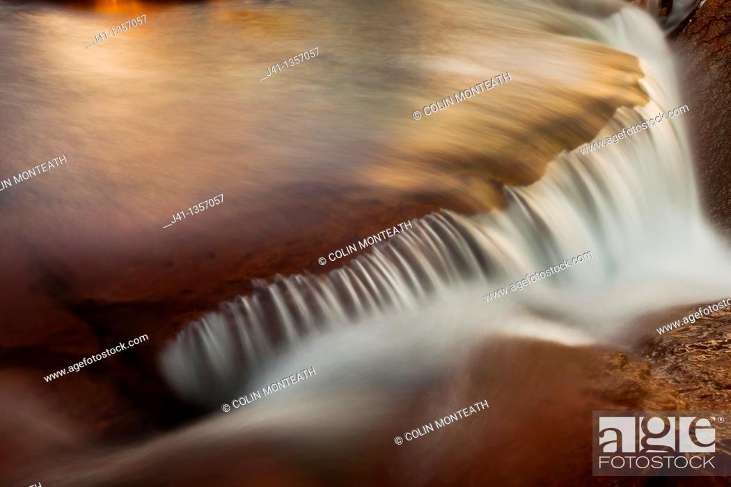 Stock Photo: FitzRoy waterfall rapid catches first rays of dawn light under famous rock peak Cerro FitzRoy  El Chalten , Parque Nacional Los Glaciares, Patagonia, Argentina.