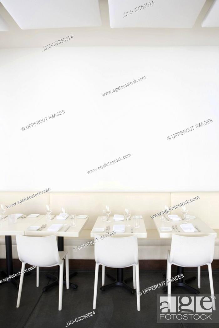 Stock Photo: Row of tables at restaurant.