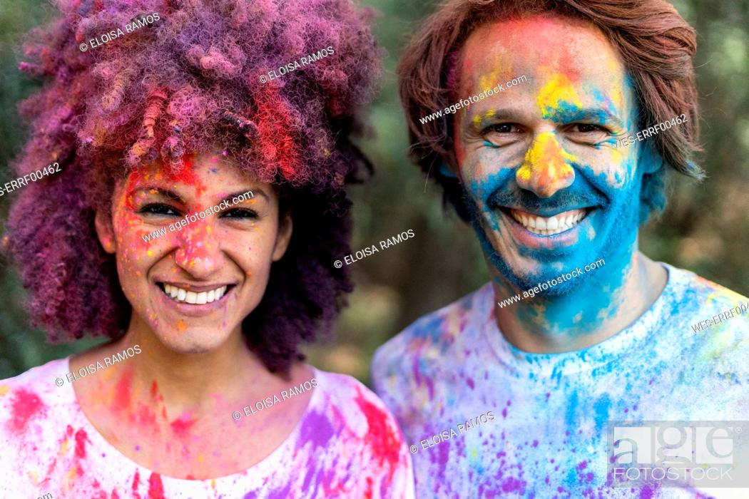 Photo de stock: Couple full of colorful powder paint, celebrating Holi, Festival of Colors.