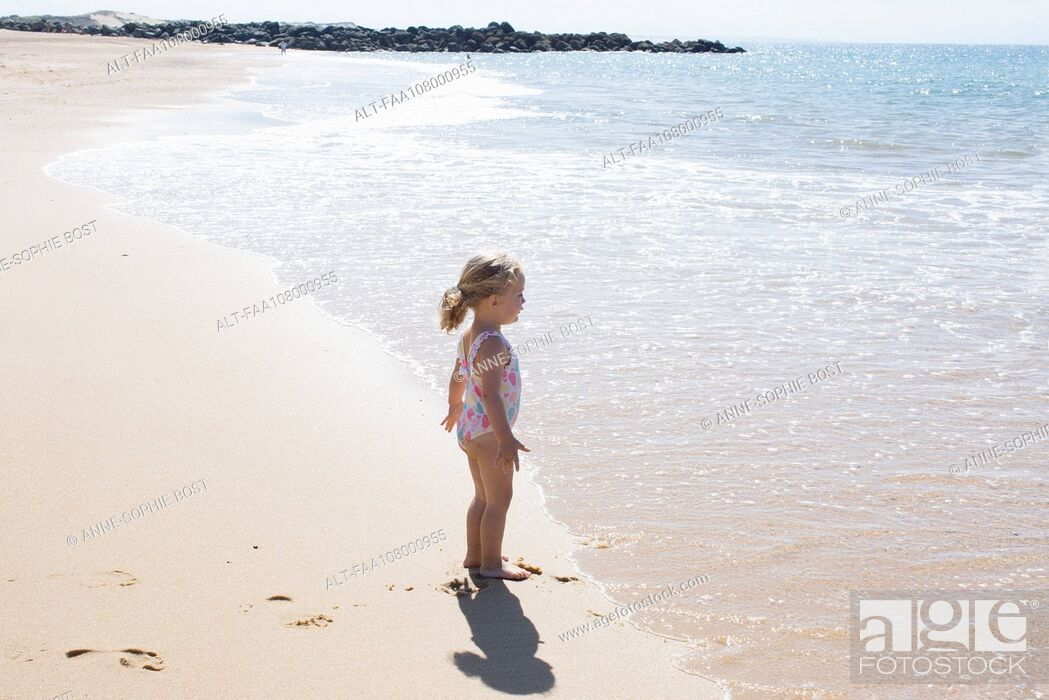 Stock Photo: Little girl staring at the sea.