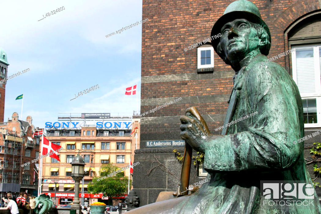 Stock Photo: Statue of Hans Christian Andersen at H.C.Andersen's Boulevard nearTownhall Square with Danish flags at city centre of Copenhagen, Denmark.