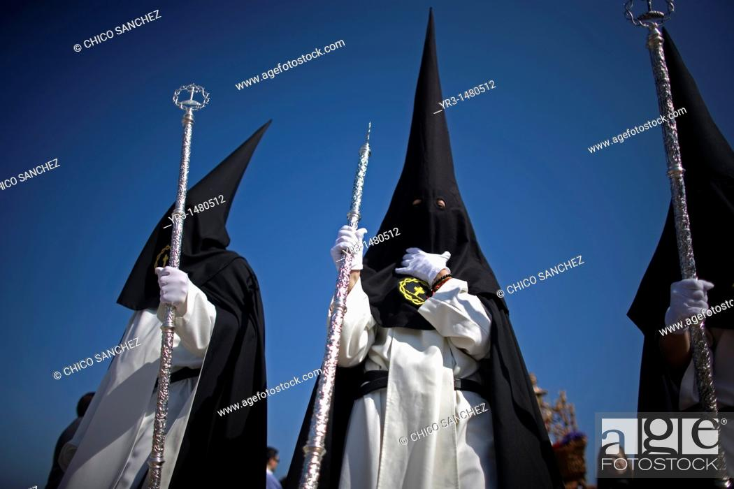 Stock Photo: Penitents of the Jesus del Silencio brotherhood, known as the Brotherhood of Love perform in an Easter Holy Week procession in Cordoba, Andalusia, Spain.
