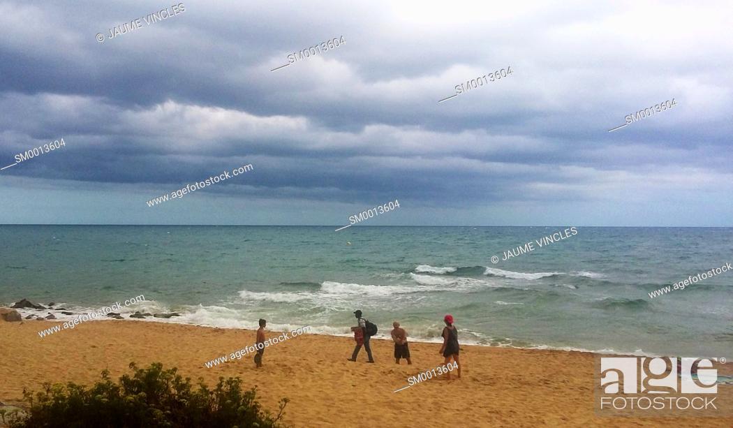 Stock Photo: Storm clouds over the beach. Caldes d'Estrac. Maresme, Barcelona province, Catalonia, Spain.