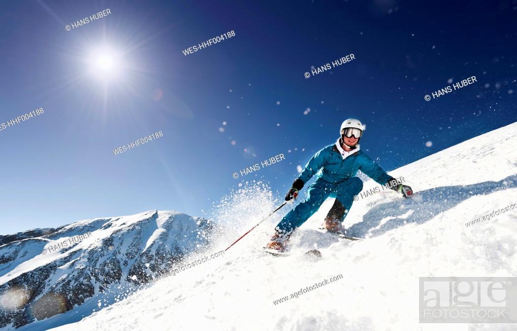 Stock Photo: Austria, Salzburg, Young man skiing on mountain.