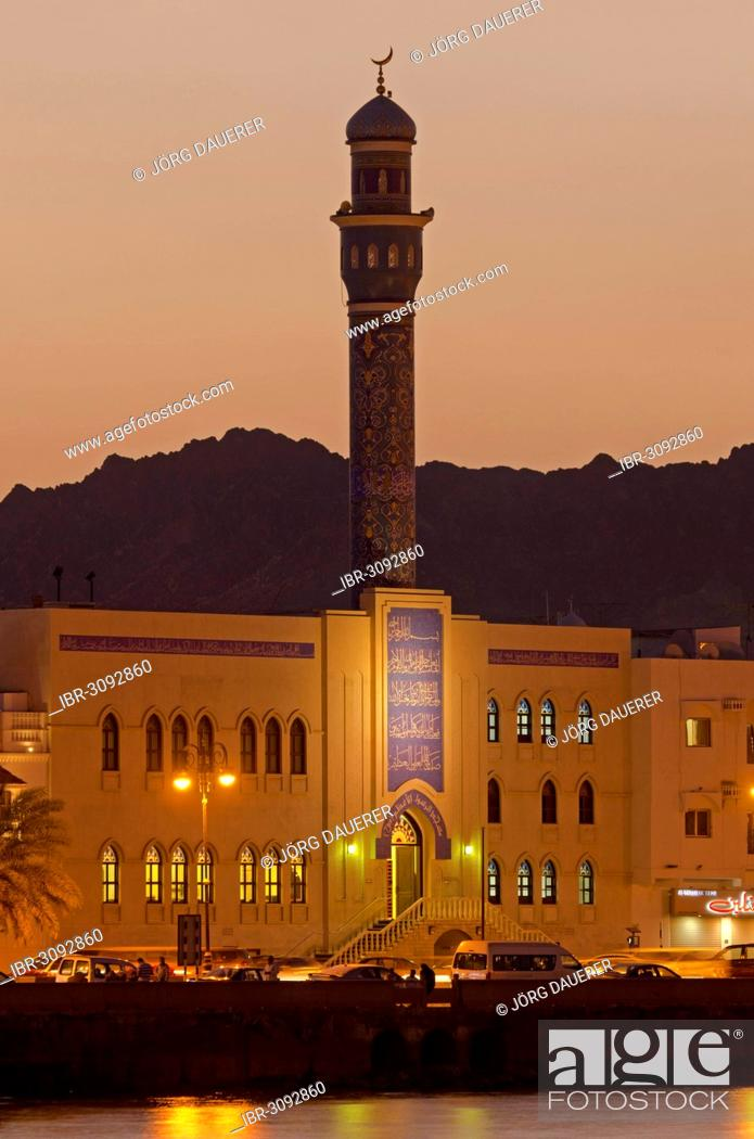 Stock Photo: Floodlit buildings at the Corniche of Muttrah dominated by the minaret of the Rasool Azam Mosque.