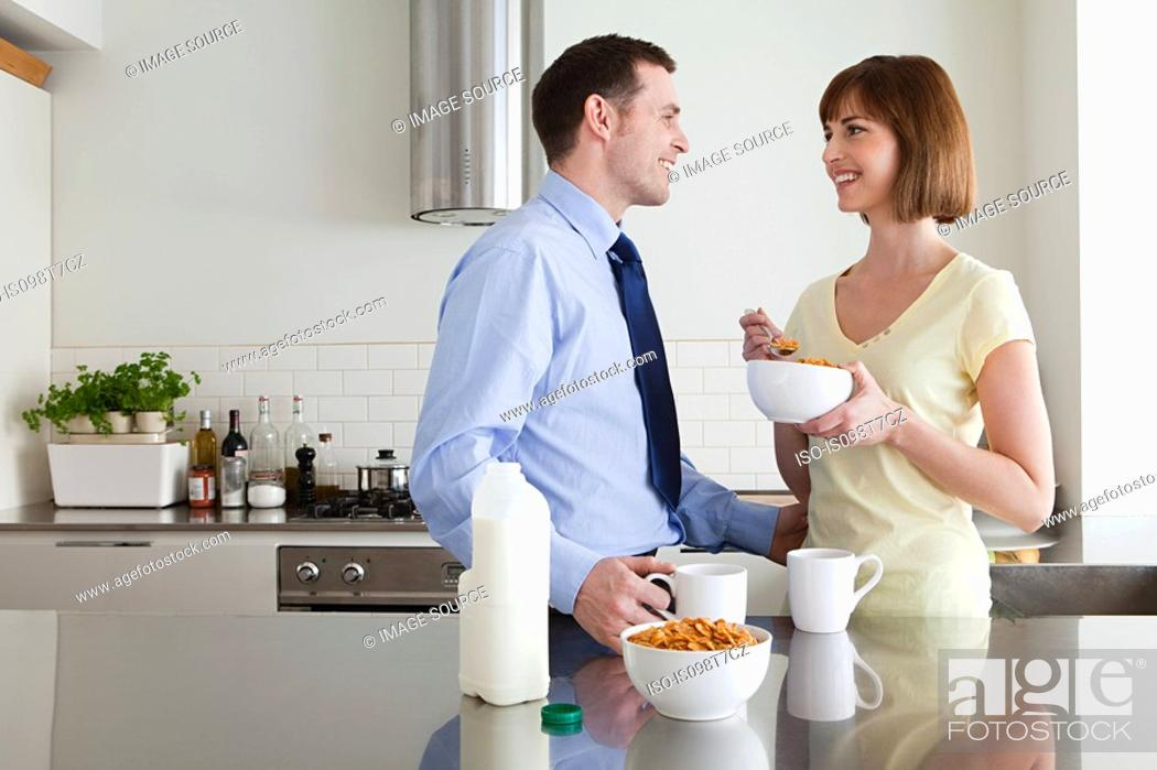 Stock Photo: Couple having breakfast.