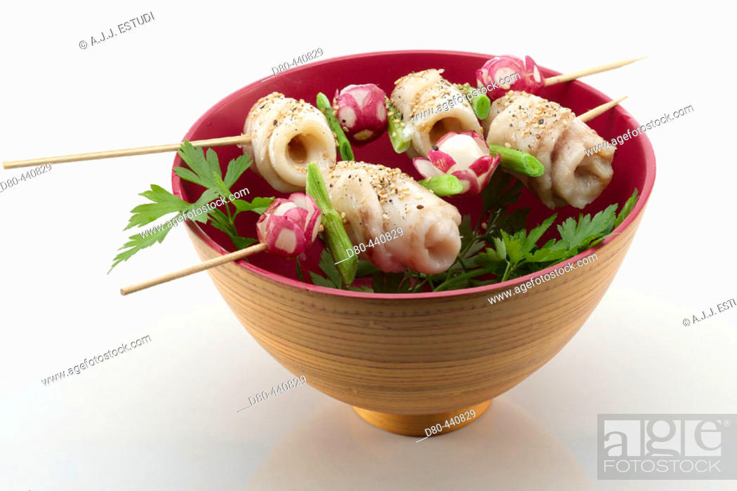 Stock Photo: Kebabs of perch and radishes.