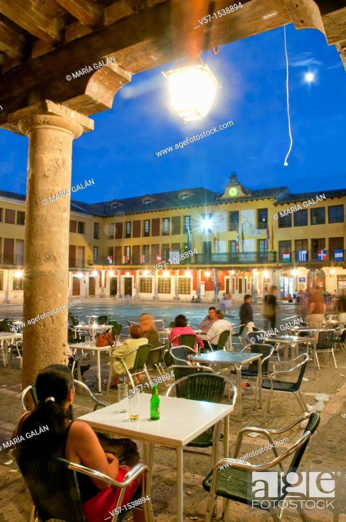 Stock Photo: People sitting on terraces at Main Square, night view. Tordesillas, Valladolid province, Castilla León, Spain.