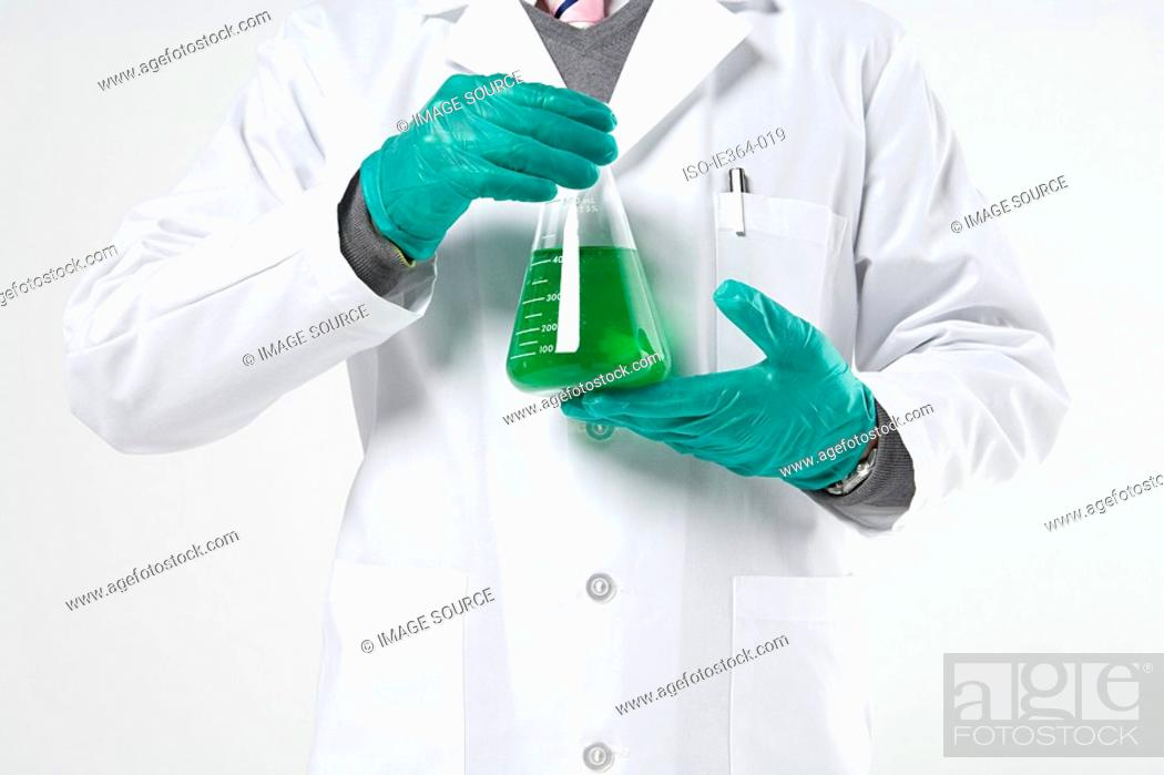 Stock Photo: Scientist holding flask.