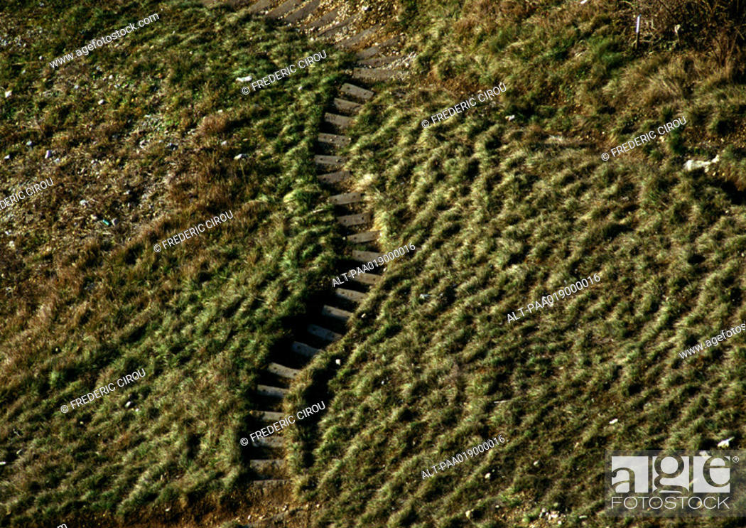 Stock Photo: Old steps in grassy hill.