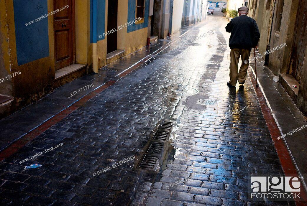 Stock Photo: old man walking on an alley, El Carmen, downtown Valencia, Valencia, Spain.