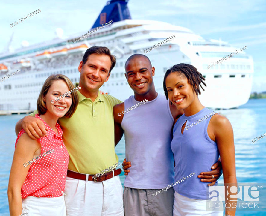 Stock Photo: Portrait of two young couples standing in front of a cruise ship and smiling, Bermuda.