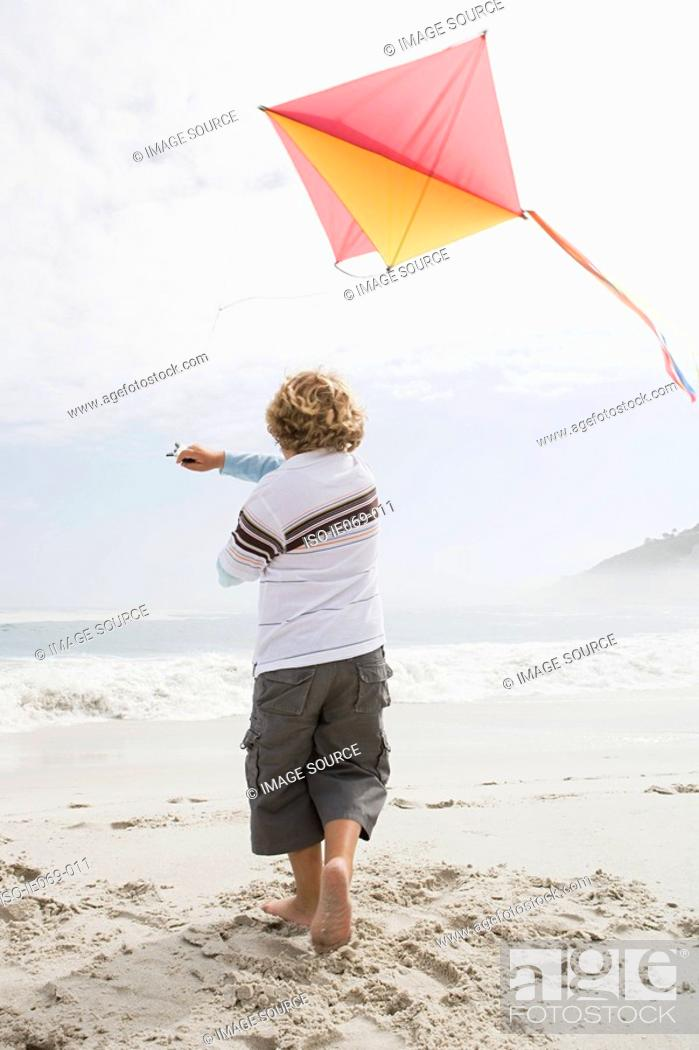 Stock Photo: Boy flying a kite.