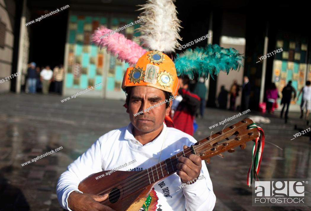 Stock Photo: A conchero from Santiago Centro, Tamzle, San Luis Potosí, performs at the pilgrimage to Our Lady of Guadalupe Basilica in Mexico City, Mexico, December 10, 2013.