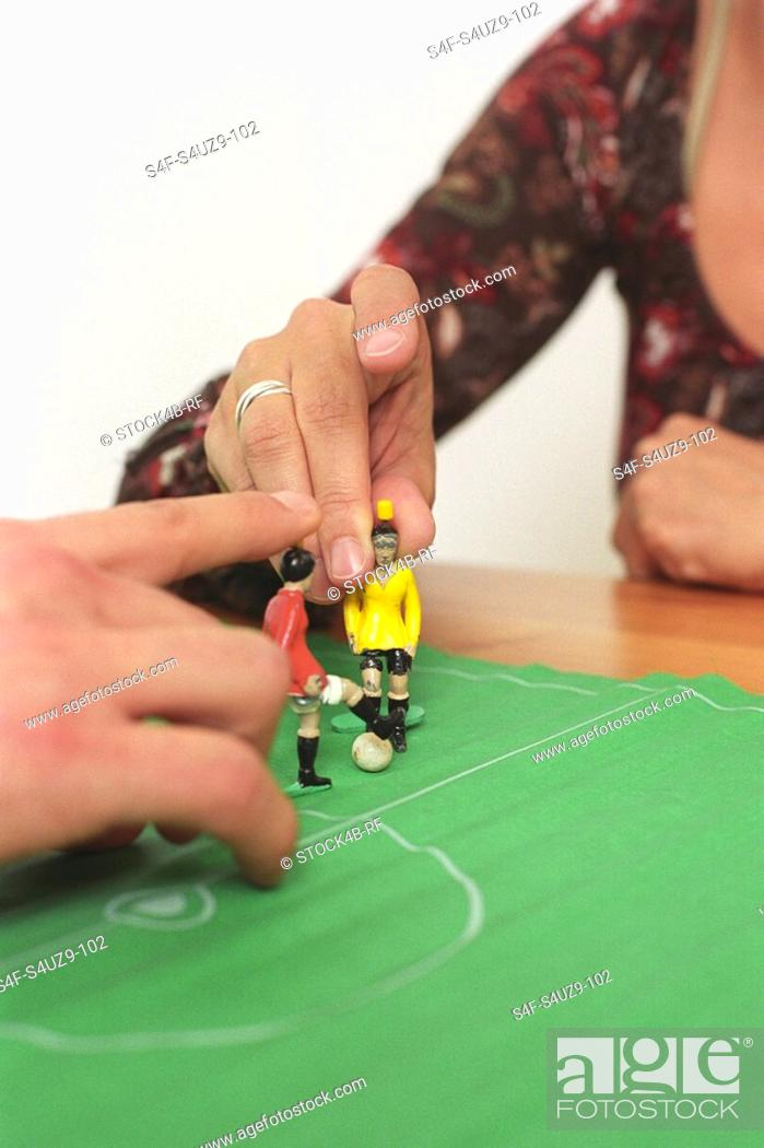 Stock Photo: People playing with a Table Soccer Game Detail.