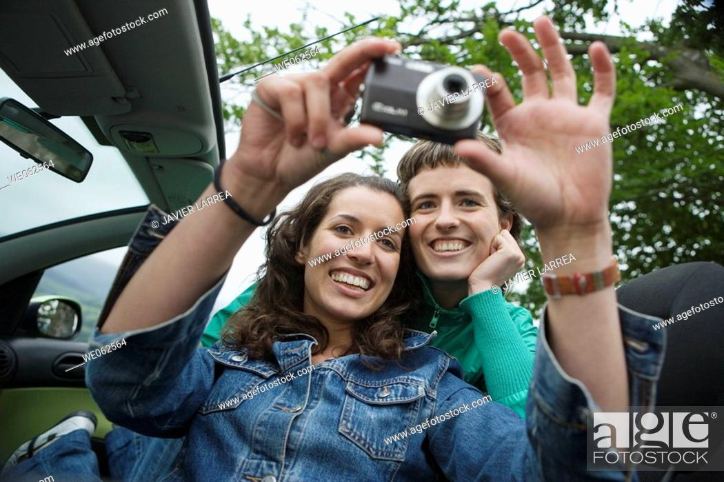 Stock Photo: Friends itaking pictures. Mirador de Udana, Oñate. Gipuzkoa, Euskadi. Spain.