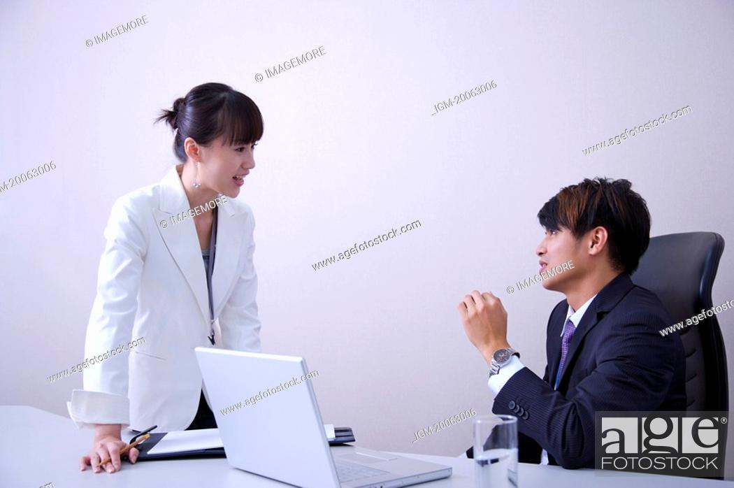 Stock Photo: Young man and woman discussing together.
