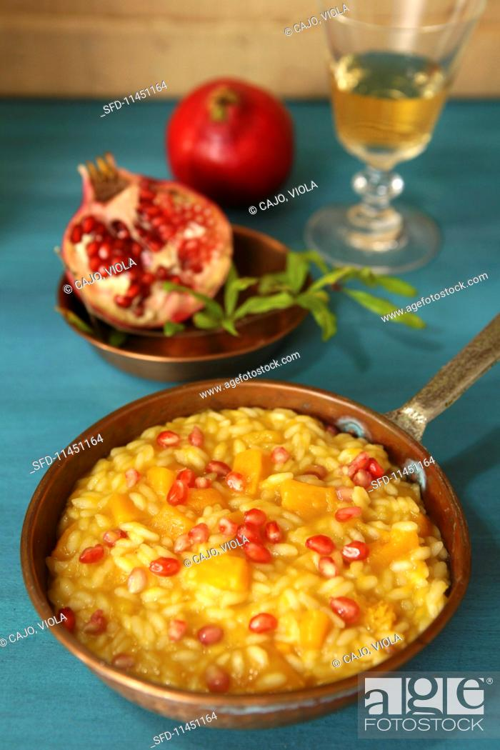 Stock Photo: Pumpkin risotto with thyme and pomegranate.