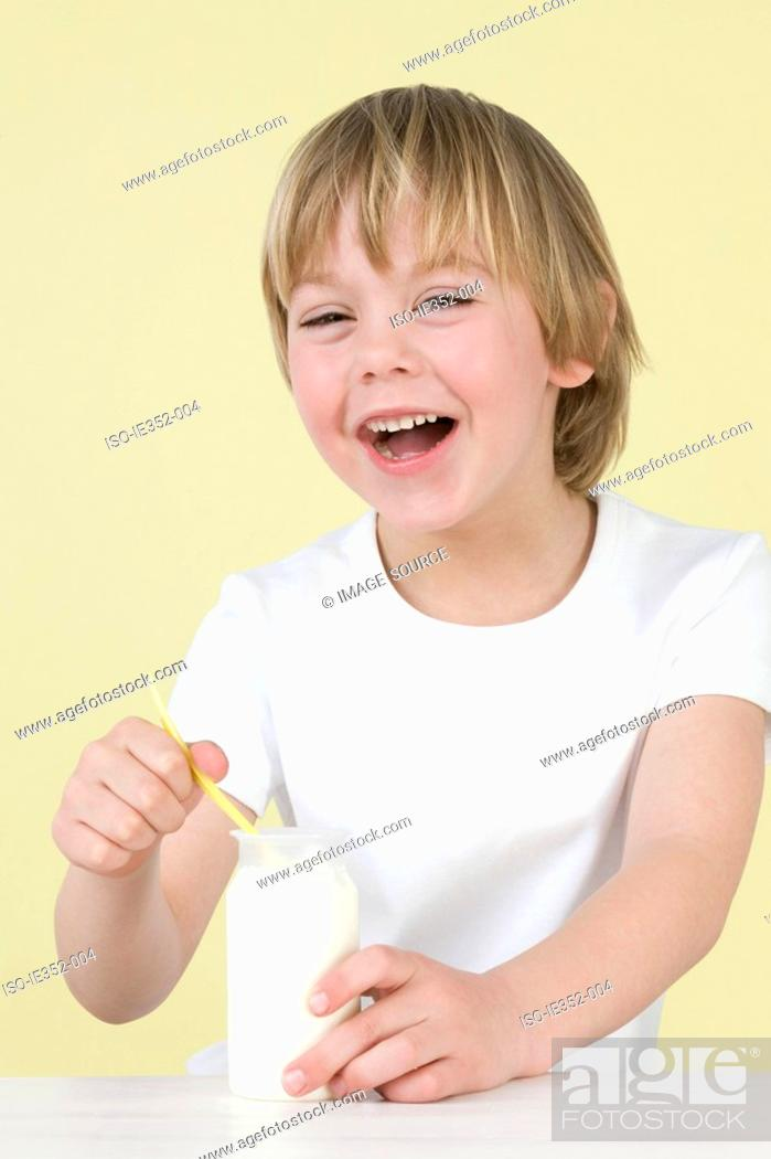 Stock Photo: Boy with yoghurt.