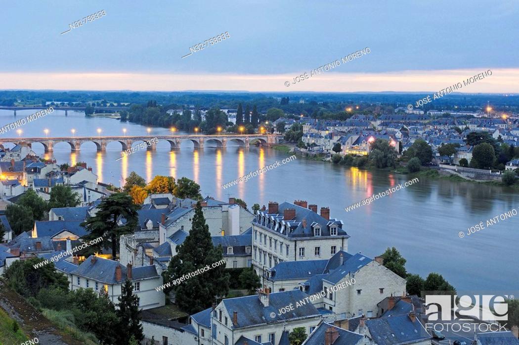 Stock Photo: Stone Bridge and Loire River at dusk. Maine-et-Loire . Saumur. Loire Valley. France.