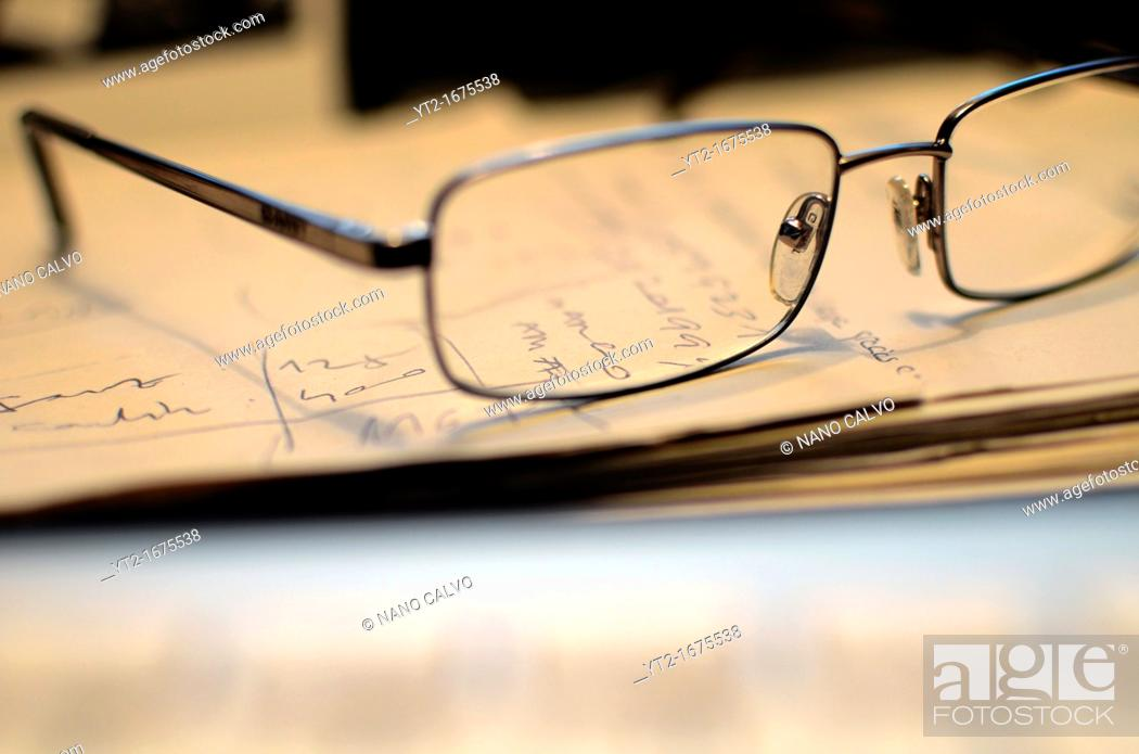 Stock Photo: Glasses and papers.
