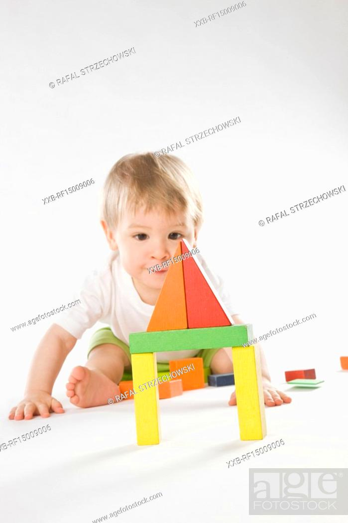 Stock Photo: baby playing with bricks.
