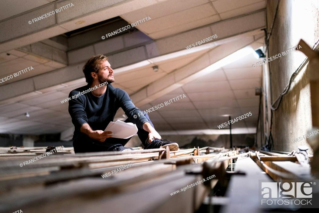 Stock Photo: Actor rehearsing with script at theatre.