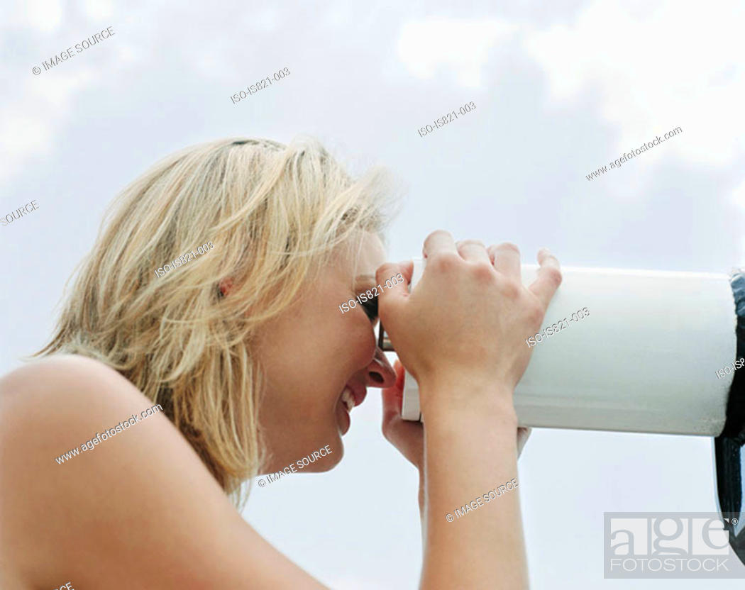 Stock Photo: Woman looking through telescope.