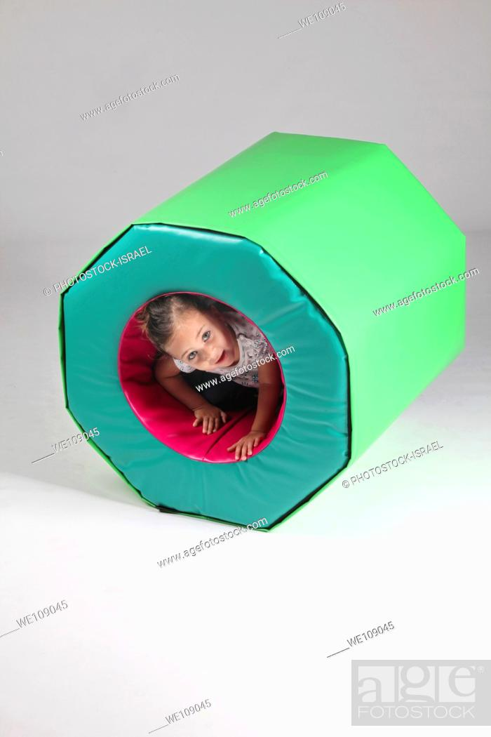 Stock Photo: Indoor playground young girl of 4 plays On white Background MR available.
